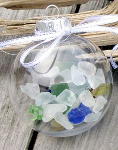 idea: collect glass from different beaches visited - label ornament to put on tree      SEA GLASS CHRISTMAS Ornament, beach decor, beach glass, nautical Christmas ornament. $10.00, via Etsy.  You could do this with sea shells also.