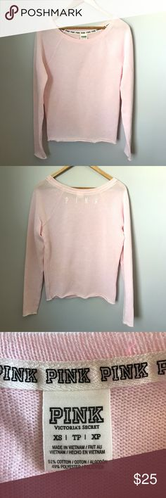 """PINK Victoria's Secret sweater. Light pink crew neck sweater with """"PINK"""" across upper back. Unfinished hems. Size XS. Measures 18"""" pit-to-pit and 15"""" long from underarm to bottom hem. Sleeve length approximately 20"""". Gently used condition. Sorry, no trades & I am unable to model. PINK Victoria's Secret Sweaters"""