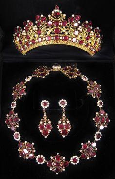 A garnet, gilt and seed pearl tiara,  Georgian. With mulitple gilt foliate scrolls set with garnets and pearls.