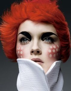 I have had this image saved on my computer LOL.. i love the FACE Make-up editorial.  Dark brows, dotted blush.