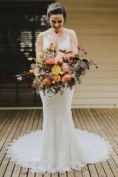 Bride wearing a mermaid lace wedding dress with a fall big bridal bouquet   NICOLA & ANTHONY Rustic Country Wedding - Lavan Photography   Loev & Lavender #wedding #weddings #rusticwedding