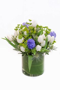 A spring bouquet of fragrant Hyacinth and Tulips nestled into an interesting bed of green and silver that is fresh and crisp.   From Marguerite Gardens Flower Shop via @Bloompop