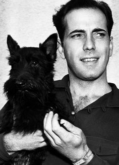 Humphrey Bogart with his pal Mac, 1937, on the set of Stand-In