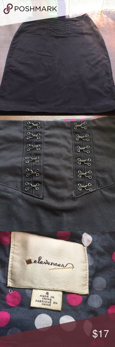 """Anthropologie Elevenses Pencil Skirt with Hooks Beautiful and classy gray skirt with hook detail on front and ribbon on the back. Side zipper. Slit in back. Waist 28"""" length 23"""". Excellent condition! Anthropologie Skirts Pencil"""