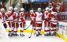 CrowdCam Hot Shot: Detroit Red Wings forward Stephen Weiss is congratulated by teammates after his overtime game winning goal against the Carolina Hurricanes at PNC Center. The Red Wings won 3-2 in overtime. Photo by James Guillory