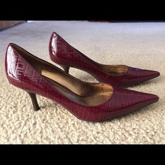 Nine West Burgundy Croc Pumps Sz. 7.5 Like new! Nine West Burgundy pumps size 7.5. Features a croc/alligator pattern with low to medium heel. In great shape with one slight tear at the bottom of the right heel... Is not readily visible. Nine West Shoes Heels