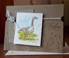 handmade card from Laura's Works of Heart: WETLANDS CARD ... masculine look ... kraft background ... Canadian Goose image for focal point ... watercolor with inks in pale blue and olive ... stamped with brown ink ... luv the tone on tone stamping of grasses and sentiment on the card base .... Stampin' Up!