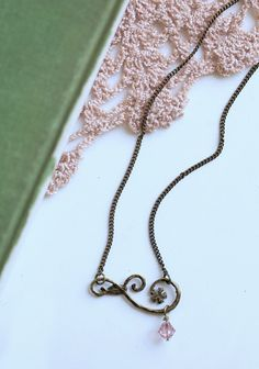 """Midsummer Dream Indie Neckalce 19.99 at shopruche.com. Indie made, this brass necklace is adorned with a delicate filigree accent and a light pink charm.  17"""" long"""