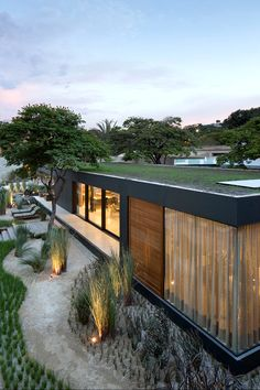 """This eco-minded home in Sao Paulo raises the bar for prefab. Made of recyclable materials and equipped with smart home technology """"Syshaus"""" is design by Sao Paulo studio Arthur Casas Design Modern Prefab Homes, Modular Homes, Minimalist Architecture, Modern Architecture, Studio Arthur Casas, Prefab Buildings, Casas Containers, Design Exterior, Container House Design"""