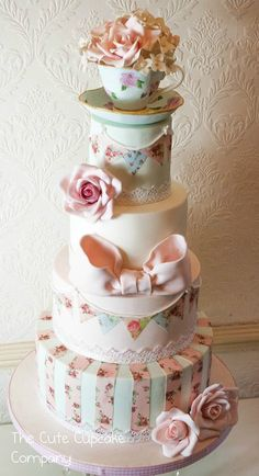 this would make a cool vintage wedding cake. you could replace the teacup with something else if you want a cake topper