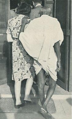 Mahatma Gandhi using my grandmother as his crutch.
