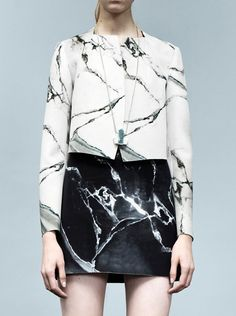 I love this marble top and skirt. Anybody know the designer?