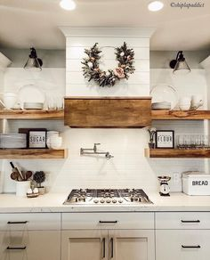 Loving the simplicity of this modern farmhouse kitchen styled by Her use of bold, industrial accents, combined with the delicacy of that darling wreath makes for a warm, yet unique space. Also take note of how beautifully the white shiplap White Farmhouse Kitchens, Farmhouse Style Kitchen, Farmhouse Homes, Industrial Farmhouse Kitchen, Rustic Farmhouse, Farm Kitchen Ideas, Home Decor Kitchen, Apartment Kitchen, Kitchen Furniture