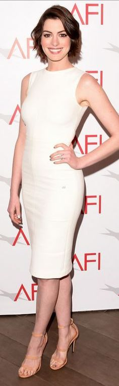 Anne Hathaway: Shoes – Protagonist  Shoes – Tamara Mellon  Earrings – Eva Fehren  Purse – Saint Laurent