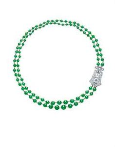A DIAMOND CLASP, BY CARTIER AND A JADEITE BEAD AND SEED PEARL NECKLACE Designed as a two-strand necklace, comprising one hundred and one graduated jadeite beads of intense emerald green colour and high translucency, measuring approximately 3.8 to 9.0 mm, alternating with seed pearls, to the old European and mine-cut diamond clasp, mounted in platinum, 47.1 cm long The clasp signed Cartier, No. 37-16743