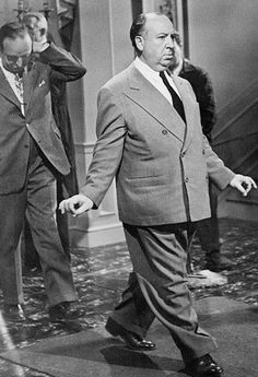 Rare picture of Alfred Hitchcock showing actors how to walk correctly, on the set of the movie The Paradine Case, 1947