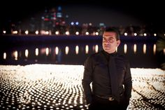 Ali Behnam Bakhtiar in front of the candles at night and black shirt