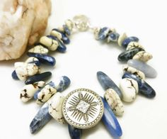 Bold and chunky natural Howlite white nugget and Sodalite stick nugget southwest style bracelet. A beautiful combination of natural white howlite and blue sodalite nugget stones. A stylish and fashionable bracelet to go with any outfit. The how...