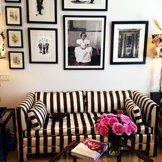 arranging pillows on black and white striped sofa - Google Search