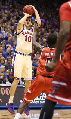 Kansas guard Sviatoslav Mykhailiuk (10) puts up a three over Texas Tech during the second half, Saturday, Feb. 27, 2016 Jayhawks Win at Allen Fieldhouse clinching the 12th straight Big XII Championship. Svi was hot making 5 of 5 3-point shots, plus another 2.