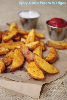 The best ever garlicky spicy and crispy baked potato wedges, try these and you are never going back to fries | http://gourmet-tastes.blogspot.com