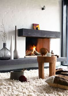 """42 Lovely Scandinavian Fireplace To Rock This Year. A stone fireplace design your pioneer ancestors would envy is the """"Multifunctional Fireplace."""" The hearth is built up high to create a storage a. Rustic Fireplaces, Home Fireplace, Fireplace Design, Fireplace Ideas, Simple Fireplace, Brick Fireplace, Rustic Mantle, Fireplace Makeovers, Wood Mantle"""