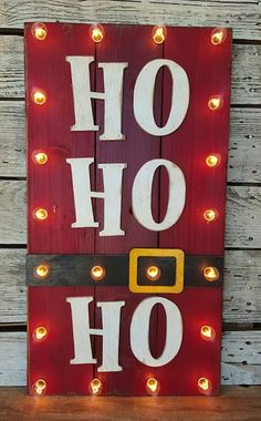 20 Fun Christmas Decorations Ho Ho Ho Wood Plank sign – simple, fun, and creative – love the lights too! You've finished your Christmas crafts and cookies and now it's time to put up your Christmas decorations. You're going to love these Christmas ideas! Pallet Christmas, Noel Christmas, Simple Christmas, Christmas Ornaments, Rustic Christmas, Diy Outdoor Christmas Decorations, Christmas Movies, Diy Christmas Projects, Diy Christmas Crafts To Sell