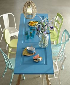 We adore this upcycled dining table! The top is a door painted in a brilliant shade of turquoise from our new spring/summer palette. Complete the whimsical look by mixing and matching chair styles and colors. These old chairs got a new life with a fresh coat of paint. Home Decorators Collection by Behr paint is available at The Home Depot®!