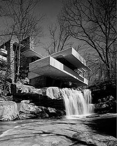 I'm almost positive that this is Frank Lloyd Wright, who was the most brilliant architect ever to have lived ever.  His homes and buildings are so distinctive that you can almost always tell he had his hand in something just by looking at it.  :]