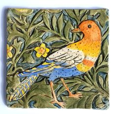 Speckled Bird Tile. This dimensional porcelain tile was inspired by William Morris 'Bird Fabric' that he designed in 1878 for the walls of the drawing room of his family home. William Morris was one of the founders of the Arts and Crafts movement in England in the latter half of the 19th Century. I hand pressed this tile in my handmade mold made from my original hand carved model. It is porcelain and is hand decorated with ceramic stains, underglazes and glazes. It has a matte finish. The...