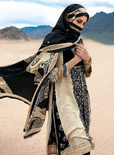 I just really love everything about this! (Abaya, hijab, niqab!) Islamic women's garb in tan and black so mysterious goddess of sands