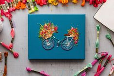 """This is the first piece of my """"Velo"""" Series meaning bike in French. This one of a kind bicycle is hand embroidered and cute as can be. -Stretched Cotton canvas -Hand Embroidered and beaded details -Hand Signed and Dated on back Piece Of Me, Courses, Cross Stitch Embroidery, Cotton Canvas, Flora, Racing, Art, Blue, Embroidered Towels"""