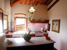 Charmingly small Mediterranean country kitchen