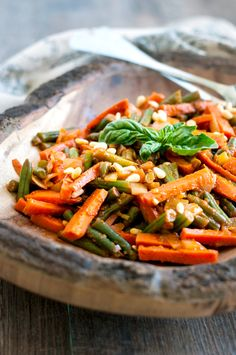 An easy recipe for Green Beans and Carrots in Tomato Sauce that will make it delicious to add more vegetables to your plate.