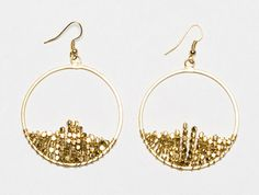 Clustered Earring in gold      $32.00  Gold nuggets nestle inside a classic hoop earring for a hint of sparkle and sophistication.    Handmade by a fair trade artisan group in India that creates avenues of employment for the economically disadvantaged.
