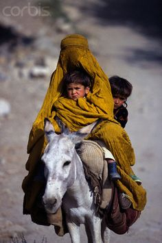 Mother with her children riding their donkey in Afghanistan