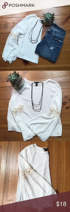 Bell Bottom Lace Shirt This top is super adorable with a pair of high waisted jeans! It has bell bottom sleeves with lace. It says it's size large but it fits more like a medium. It's from forever 21! NOT FREE PEOPLE. Free People Tops Blouses