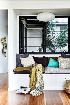 A wasted space in this country Queensland home was turned into a built in seating nook off the living room. Louvred windows lend a tropical air. And big ticks for the generous storage underneath. Photography: Kristina Soljo | Styling: Sarah Ellison