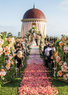 8 Ombré Wedding Ideas That Are Too Pretty Not To Try: What's better than you walk down the aisle? An aisle lined with ombré rose petals! Photo by Samuel Lippke Studios; Floral by White Lilac, Inc.