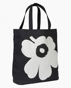 The Torna bag is made of heavyweight cotton canvas and it features the Unikko (poppy) pattern on one side. It has two handles and an inside pocket. The material is printed in Helsinki.Marimekko's famous poppy pattern Unikko was born in 1964 Marimekko Bag, Large White, Black And White, Textiles Sketchbook, Scandinavia Design, Poppy Pattern, Carry All Bag, Beautiful Handbags, Black Tote Bag