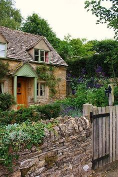 #cottage with rock fence and garden