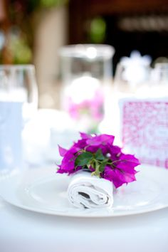 Fuschia bougainvillaea used on these napkins, allow local flowers to be used at this Ibizan Wedding