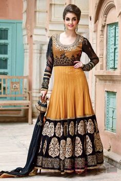 Floor length anarkali suit embellished with embroidered and khatli worked patches, along with diamond-studded dupatta. Comes with stylish wristlet bag.