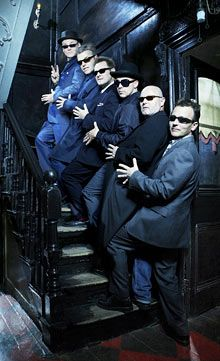 """Madness take to the stairs at Dennis Severs' House. Photograph: Neil Wilder. Interview with Carl on the release of """"Norton Folgate,"""" 2009."""