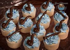 Jean Marie's Cakery ~ Vanilla Cupcakes with Vanilla Buttercream Frosting.  These have custom molded chocolate instruments, saxophones and clarinets, on top and custom colored sprinkles!