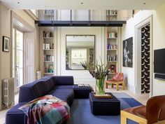 A once cramped, Victorian-era townhouse in north London was transformed into an airy, comfortable family home for a famous rock star and his family by New York-based Ashe + Leandro. Home Living Room, Living Spaces, Apartment Living, London Townhouse, Room London, Family Room Design, Naomi Watts, Design Firms, Stores