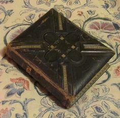 antique Victorian black leather photo album with carte de visite photographs CDVs. $125.00, via Etsy.