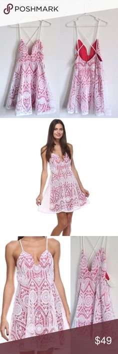 """Tea n Cup Lace Crisscross Dress Super structured lace overlay dress. Boning in side of bust to keep the structure clean and precise. Bright red slip underneath, white lace overlay, makes it appear a deep reddish pink. // Zip back, crisscross straps, well made, sturdy structure. // Front length is taken from top of bust, back measurement is taken from under armpit, so theres added length with straps (Front: 3-4""""// Back: 9-10"""") // Waist is taken from right under bust// Front Length: 30.5"""" Back…"""