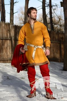 Here is a modern recreation of a middle ages outfit. The man is wearing leggings with his belted doublet. The sleeves were set in for the first time during the middle ages. He is holding a cape which he would wear for warmth.