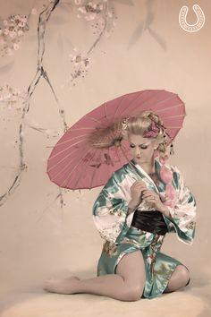 Blonde geisha girl congratulate